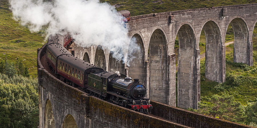 Steam train on viaduct