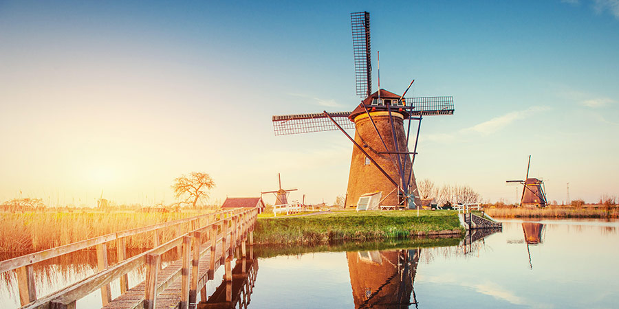 Windmill on canal Holland