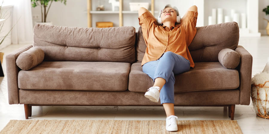 Woman listening to music on couch